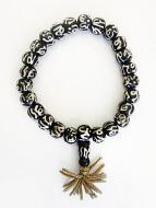 Mala stretch bracelet with batik bone beads featuring the sanskrit symbol