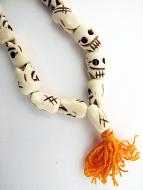 closeup of skull bone mala bracelet
