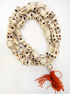 Prayer bead mala strand of 54 fancy carved bone skull beads