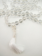 closeup detail of knotted crystal mala strand