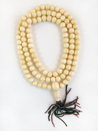 coiled strand of bone mala beads