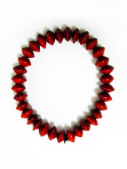 Red Rondel Seed Bracelet- seeds from the red sandalwood tree strung on with elastic cord