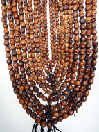 10pc assortments of tiny, small and original wood skull mala