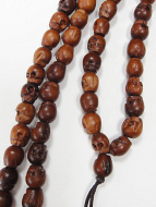 Prayer bead mala strand of 108 carved small wood skull beads