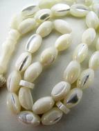 closeup of mother of pearl prayer beads