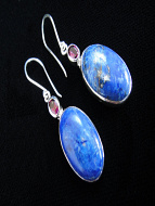 Sterling silver earrings featuring lapis with either round or oval shaped garnet accent stones