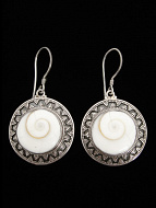 Sterling silver earrings featuring natural Eye of Shiva shell with decorative silver granulation setting