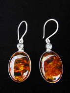 Sterling silver earrings featuring amber with aquamarine accent stones.