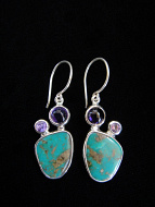 Sterling silver earrings featuring Turquoise with Amethyst accent stones.