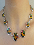 view of Rainbow Sunset necklace on model