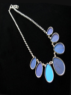 Blue Morpho (Morpho didius) Shimmerwing necklace with graduated teardrop-shaped wings set in sterling silver with adjustable chain