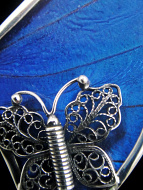 Closeup of large Shimmerwing pendant - butterfly set in sterling silver setting