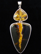 Sterling silver pendant featuring fossil ammonite and star rutile quartz