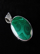 Sterling silver pendant featuring malachite stone with decorative filigree bail
