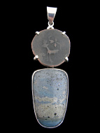 unique pendant featuring ancient Kushan period coin with the image of a deer set in sterling silver above leland blue