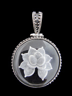 Sterling silver pendant featuring quartz crystal carved with the image of a lotus