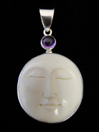 Sterling silver pendant featuring carved bone
