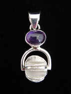 Sterling silver pendant featuring a handmade silver bead suspended below amethyst accent stone