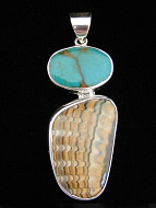 Sterling silver pendant featuring turquoise set above a peice of fossilized Humboldt clam shell