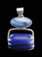 Sterling silver pendant featuring an Antique African Trade Bead suspended below a natural kyanite stone