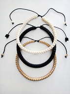 Adjustable Snake Vertebrae Chokers with black stain, light stain, or natural white finish