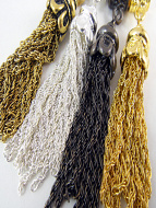 Closeup of mix-and-match sterling silver, gold-tone, brass-tone or bronze-tone plated brass tassels with bails.