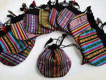 Small cotton drawstring pouches handmade in Nepal from traditional handwoven Bhutanese cotten fabric