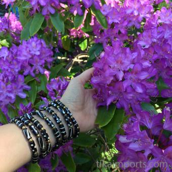 Batik Bone Bracelets shown being worn out in nature