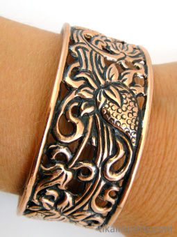 Pure copper cuff bracelets, made using traditional repouse techniques.