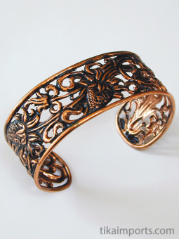 Pure copper cuff bracelets, hand fabricated in Java, Indonesia, using traditional repousse techniques.