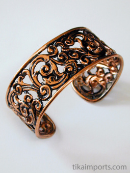 Pure copper cuff bracelets, made using traditional repouse techniques