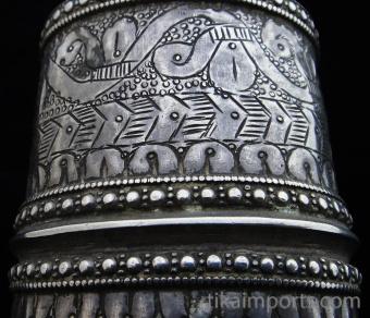 closeup detail of single antique Afghani silver cuff