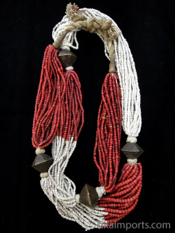 Antique beaded multi-strand necklace from Orrissa, shown coiled