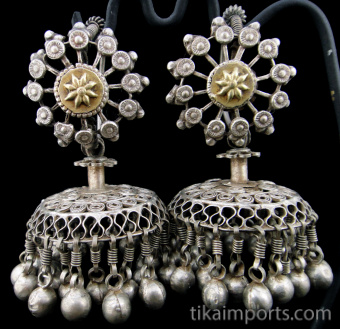 closeup of Antique Afghani Silver hoops with silver filigree bell-shaped ornament