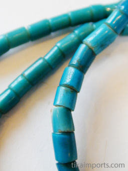 closeup of Turquoise Whitehearts, african trade beads made in the 1900's in Venice Italy and traded in Africa