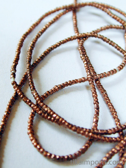 closeup detail of Contemporary Traditional tiny African Copper-Thread beads.