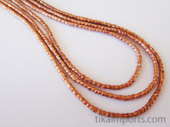 Contemporary Traditional tiny African Copper-Thread beads.