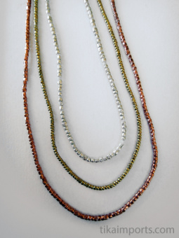 tiny African copper, brass and silver-brass thread beads.
