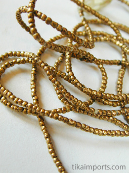 closeup view of Contemporary Traditional tiny African golden brass-Thread beads.