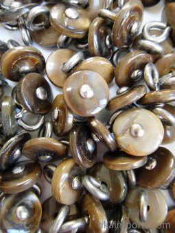 100 pieces of Khaki Victorian shell boot-buttons, made in Muscatine, Iowa