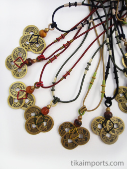 Assorted adjustable cord necklace with pendant made from three brass Chinese coin replicas, horn, and brass accent beads.