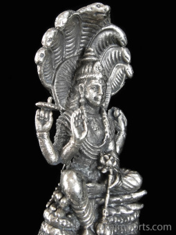 Vishnu brass deity statue, the Supreme Being, protector of the universe seated on the coiled serpent Shesha