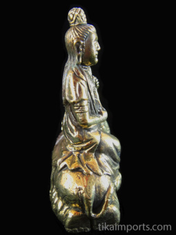 side view of QuanYin brass deity statue, the Goddess of Compassion seated on an elephant
