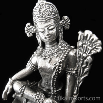 closeup of Indra brass deity statue ~ king of gods, king of the heavens