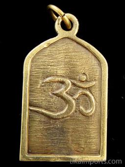 reverse view of Shiva brass deity pendant, showing 'om' symbol on back