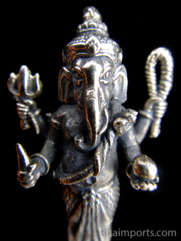 Closeup of standing Ganesh brass deity statue, the remover of obstacles