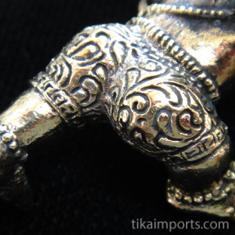 closeup of Young Crawling Ganesh brass deity statue, the remover of obstacles