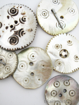 closeup of natural mother-of-pearl shell buttons from the mountain village of Gilgit in Northern Pakistan
