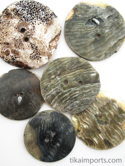 showing the back side of natural mother-of-pearl shell buttons from the mountain village of Gilgit in Northern Pakistan