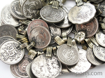 closeup of a typical hank of old afghani coin pendants